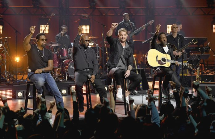 NASHVILLE, TN - Brett Young and Boyz II Men perform at CMT Crossroads with Boyz II Men and Brett Young - Music Industry Weekly